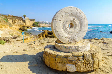 View of an old Millstone on the coast, in Achziv national park, northern Israel Imagens