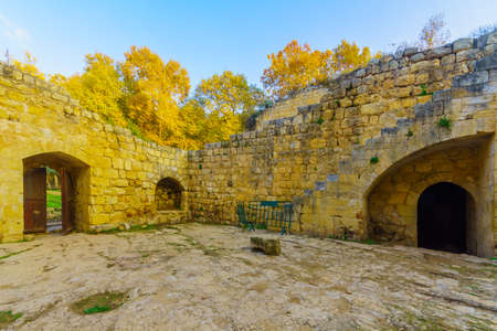 View of a Crusader farmhouse, with trees, and fall foliage in En Hemed National Park (Aqua Bella), west of Jerusalem, Israel