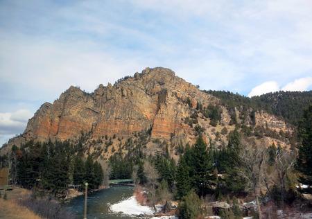 wispy: Rocky Mountain Under the Wispy Clouds