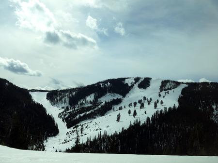 Snowy Ski Trails on Mountainside