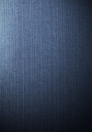 Real blue jeans denim texture, shaded background