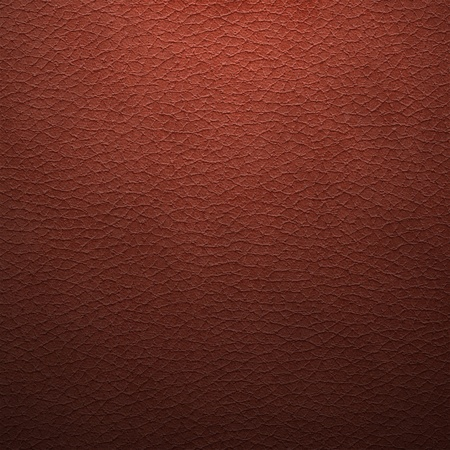 Old synthetic leather background, shaded dark red color photo