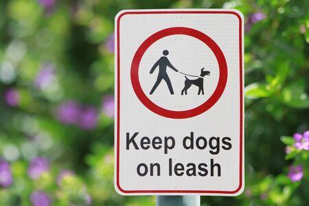 leash: Pet sign at a park Stock Photo
