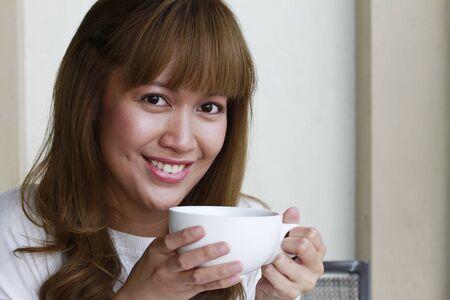 sip: Woman having coffee