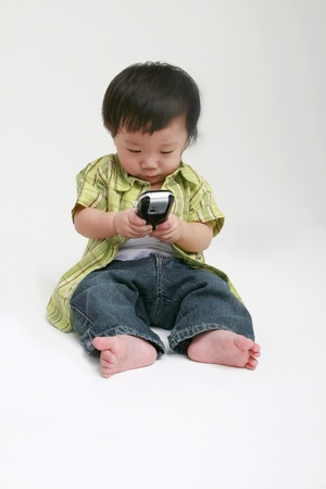 Cute toddler with a mobile phone photo