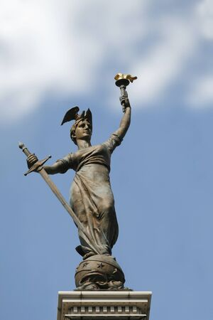 The Lady Victory statue at the peak of the Soldiers' and Sailors' Monument in Indianapolis, Indiana Stock Photo - 11789254