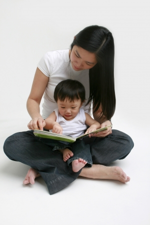 Woman and child looking at a book photo