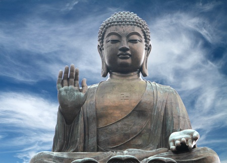 big buddha: The Tian Tan Buddha in Hong Kong in a  dramatic sky background   Stock Photo