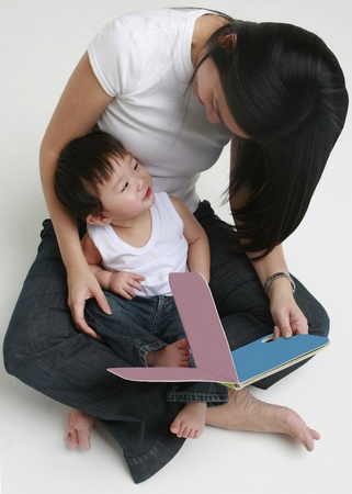 A woman and a child reading a book photo