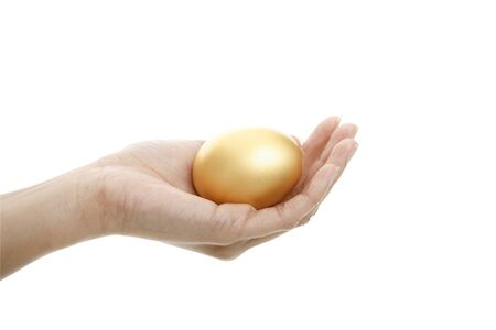 priceless: Hand with a golden egg isolated on white background Stock Photo