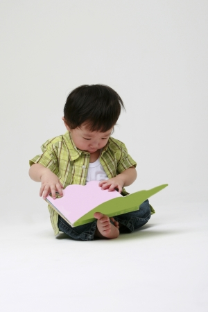 Cute toddler with a book photo