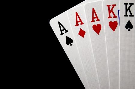 """cartas de poker: """"Full House"""" cartas de póquer sobre fondo negro Foto de archivo"""
