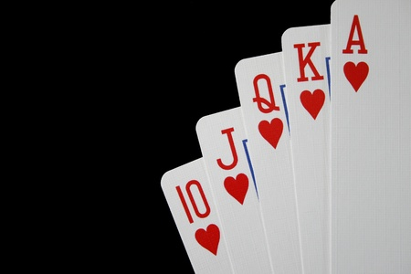 ace hearts: Royal flush of hearts on black background  Stock Photo