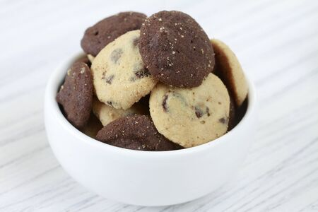 choco chips: A bowl of chocolate chip cookies