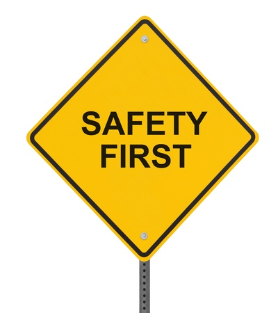 safety slogan: Safety First sign isolated on white (with clipping path)