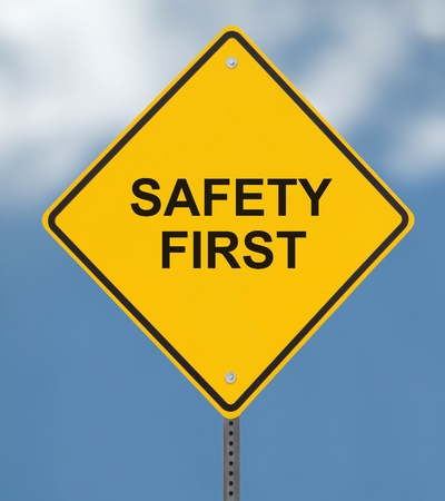 safety slogan: Safety First sign on a blue sky background (with clipping path)