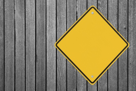 A blank warning sign on a wooden fence  Stock Photo - 12050840