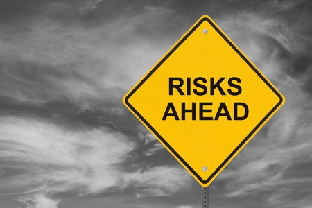 """""""Risks Ahead"""" sign on a stormy sky background  Stockfoto"""