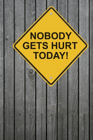 safety slogan: �Nobody Gets Hurt Today� safety sign on a wooden fence  Stock Photo