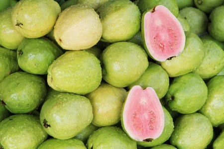 guava: Fresh guavas with pink flesh being sold in a Vietnamese market