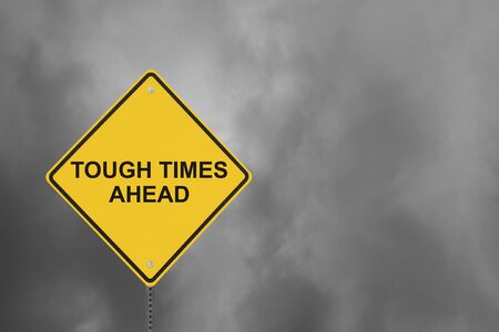 bad times: Tough Times Ahead sign with a gloomy sky background  Stock Photo