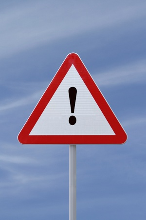 exclamation sign: Warning sign on a sky background
