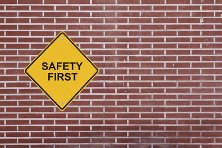 Safety First sign on a brick wall Stock Photo - 12883441