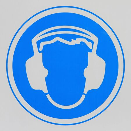 ear protection: Actual warning sign on hearing protection requirement in an industrial workplace  Stock Photo