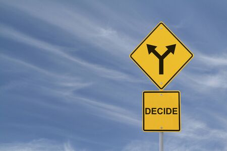 Conceptual road sign on decision making  photo