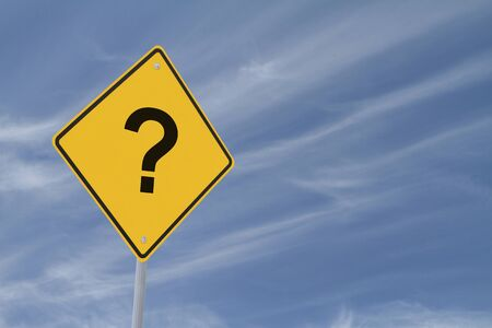 A warning sign with a question mark with a background of a blue sky and light clouds Stock Photo - 13176172