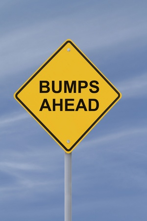 """Conceptual sign on """"bumps"""" or """"challenges"""" down the road photo"""