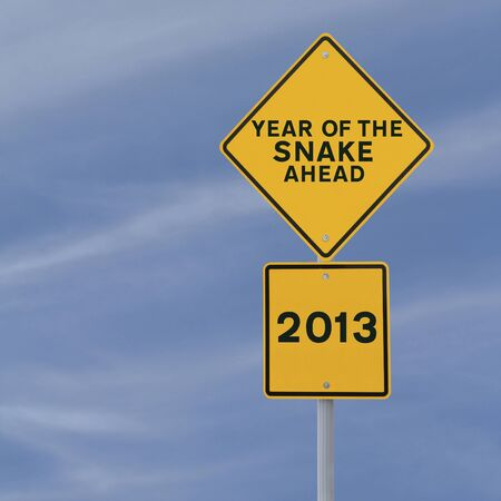 A road sign announcing the coming of 2013, the year of the snake  photo