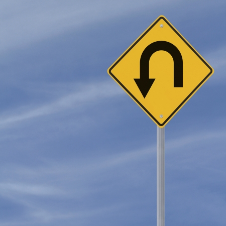 turn sign: U-turn road sign on a blue sky background with copy space