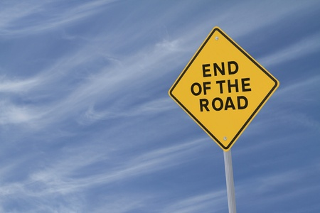 """end of road: """"End of the road"""" warning sign on a blue sky background  Stock Photo"""