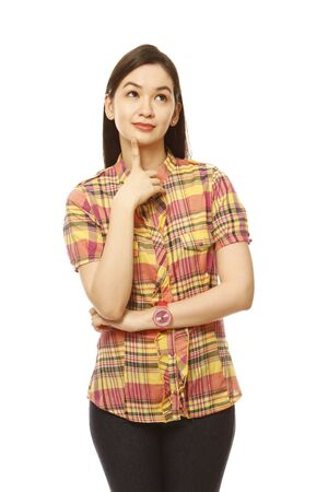 A pretty young woman thinking. With white background. Clothing and accessories generic or unbranded.  photo
