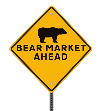 Road sign indicating a bearish market ahead  Isolated on white Stock Photo - 13752866