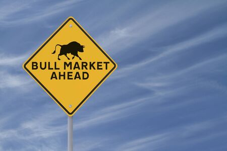 bullish market: A modified road sign indicating a Bull Market Ahead on a blue sky background  Stock Photo