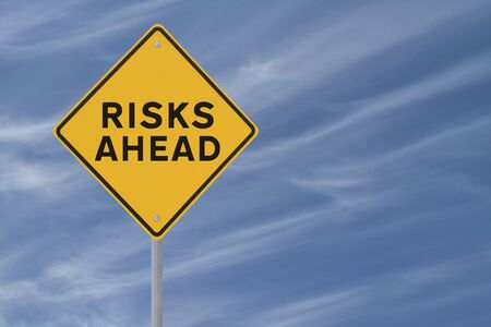 risks ahead: Risks Ahead sign on blue sky background
