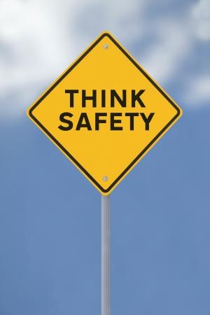 think safety: Think Safety sign on a soft sky background