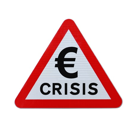 monetary devaluation: A road sign warning of a euro currency crisis