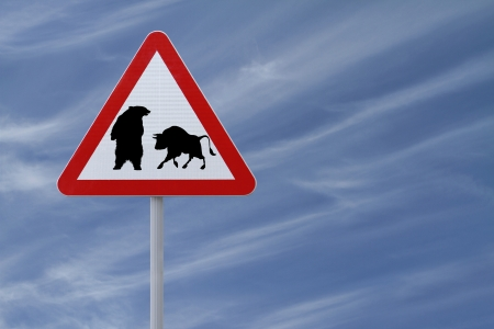 A conceptual road sign on business or finance implying market uncertainty (i.e. BEAR or BULL). On a blue sky background with copy space. Stock Photo - 13827130