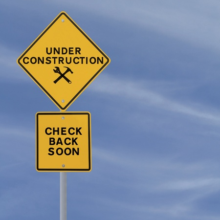 under construction: Under construction sign on a blue sky background  with copy space   Applicable for website and web page status updates   Stock Photo