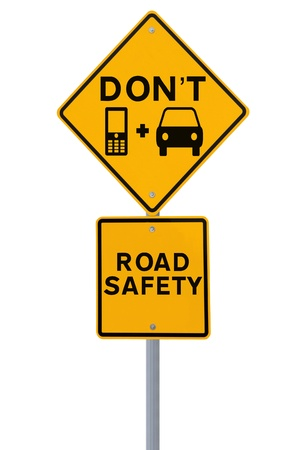 Modified road sign highlighting the danger of texting and driving  isolated on white   photo
