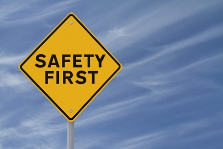 Safety First sign against  a blue sky background