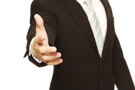 Een man in een pak met een handdruk Stockfoto - 14091346