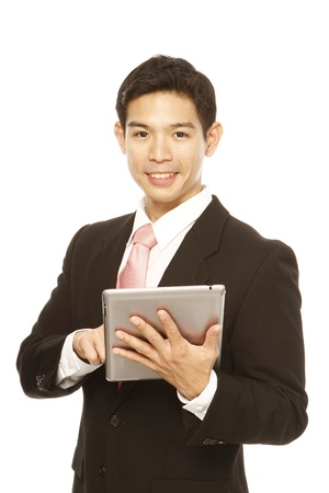 Man in business attire using a tablet computer