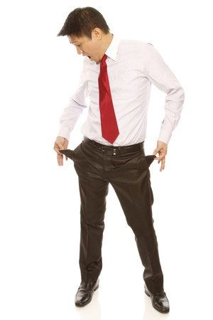 Funny businessman with empty pockets photo