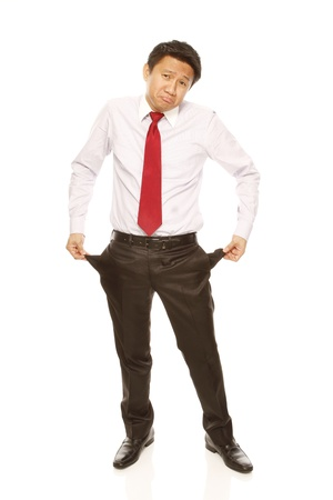 Sad businessman with empty pockets photo