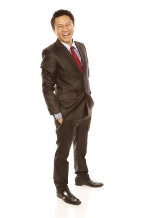 A man in business attire happy and laughing (isolated on white)  photo