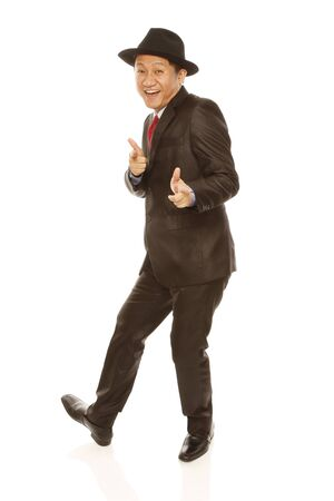 fedora hat: A jolly man in business attire and hat strikes a pose (isolated on white)